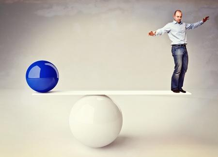 balance ball: caucasian man try to balance himself background