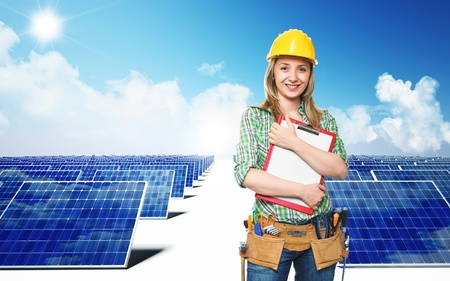 solar collector: smiling engineer and solar panel background