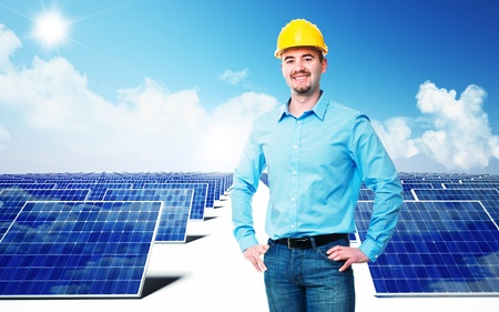photovoltaic power station: confident engineer and solar panel background