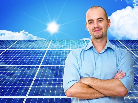 electric green: confident man and power solar station