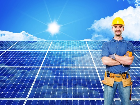 standing worker and solar panel background photo
