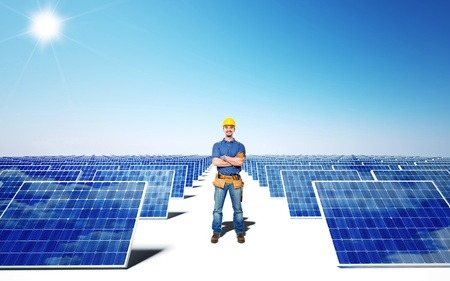 solarcell: standing worker and solar panel background