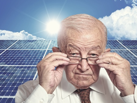 solarcell: 3d image of classic solar panel and old man portrait