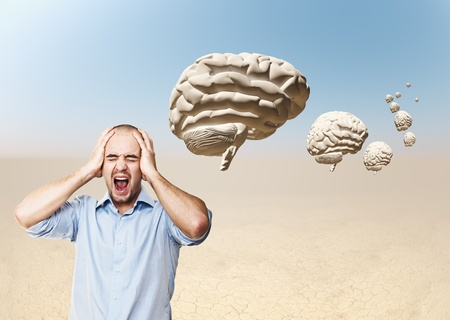 brain storm: desperate businessman and 3d brain in desert