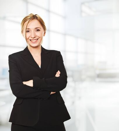 smiling woman portrait in modern office photo