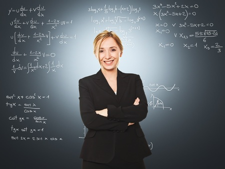 smiling young blonde teacher and board photo