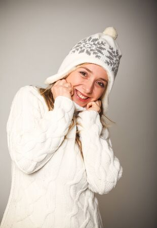 smiling young woman with jumper and winter cap Stock Photo