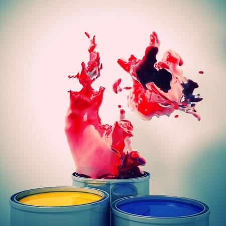 descriptive colours: 3d image of color metal tank and splash Stock Photo