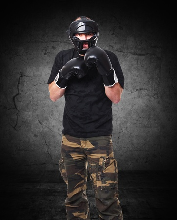 krav maga athete and grunge background photo