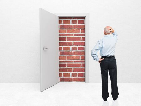 standing old man and door with brick wall Stock Photo - 12381483