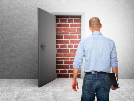 unavailability: standing business man and closed door