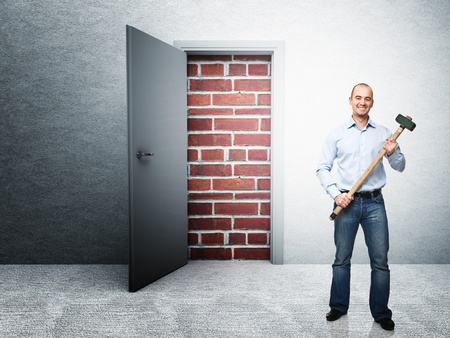 unavailability: standing man with hammer and closed door