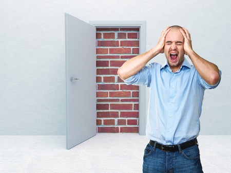 unavailability: stressed man and closed door Stock Photo