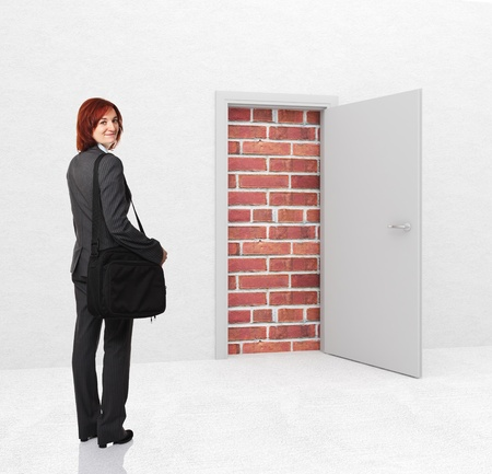 business obstacle: standing woman and closed door