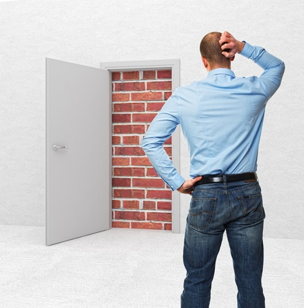 standing business man and closed door Stock Photo - 12381485