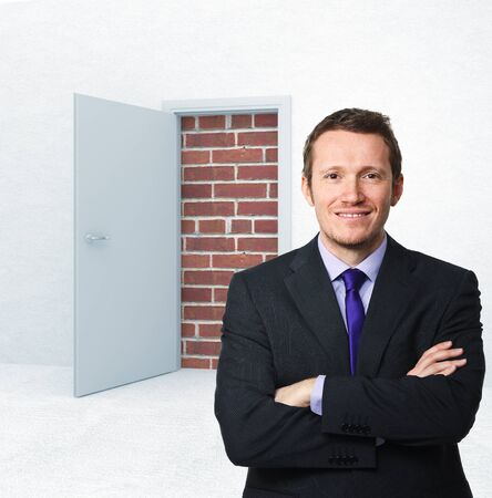unavailability: caucasian businessman and 3d door with brick wall