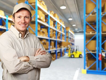 storage warehouse: smiling delivery man in warehouse