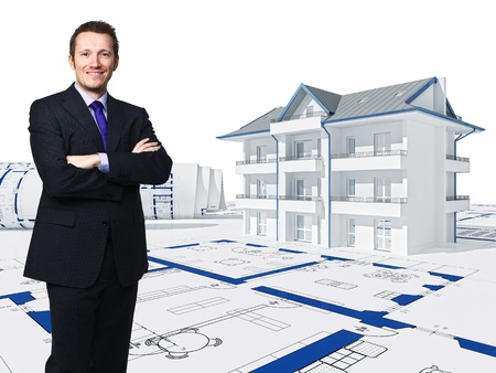 standing businessman and 3d house photo