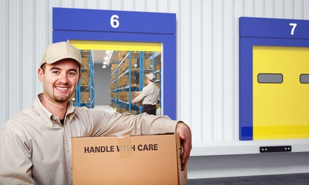 smiling delivery man and warehouse background photo