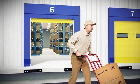 young worker on duty and warehouse background Stock Photo - 12381351
