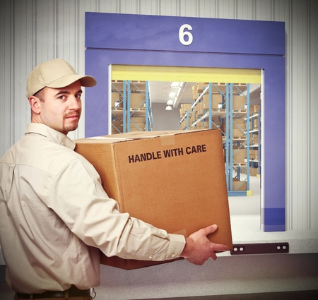 confident delivery man and warehouse background photo