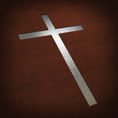 image of silver cross on leather cover photo