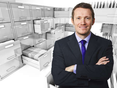 file cabinet: smiling young worker and file cabinet background