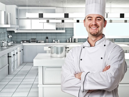smiling young chef in modern kitchen photo