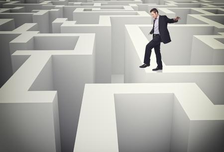 caucasian man walk on 3d maze photo