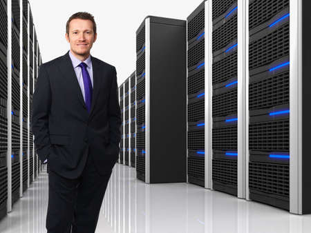 data storage: 3d image of datacenter with lots of server and man Stock Photo