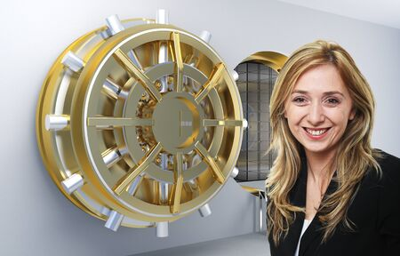 bank vault: smilinmg woman and vault background Stock Photo