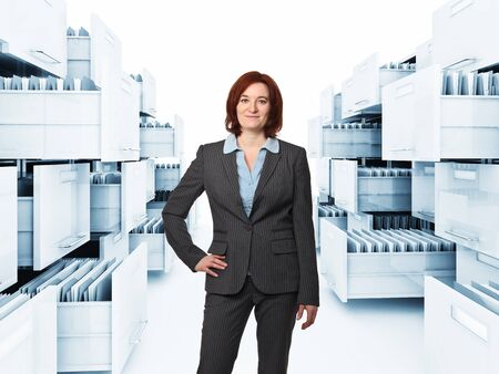 classic file cabinet with folderand standing woman Stock Photo - 12667478