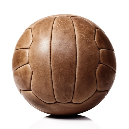 vintage football ball on white background photo