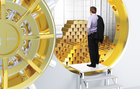 man and vault with golden bars Stock Photo - 12667523