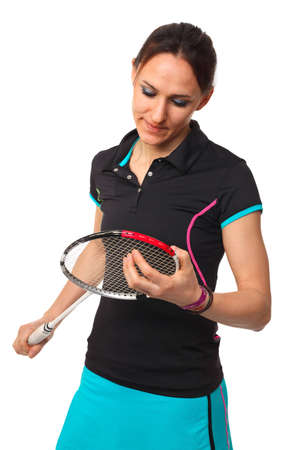 woman look her badminton racket isolated on white photo