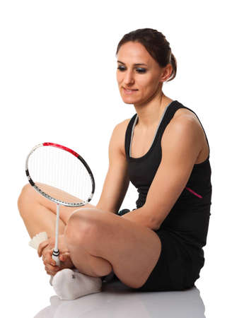 portrait of caucasian woman with badminton racket photo