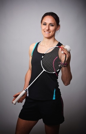 portrait of caucasian woman play badminton photo