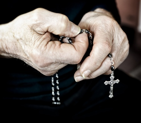 old man hands with classic rosary photo