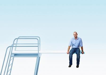 springboard: sonriente hombre sentado en el trampolín de 3d Foto de archivo