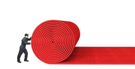 rolling: 3d red carpet on white background Stock Photo