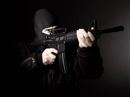 portrait of criminal with m4 rifle Stock Photo - 13047837