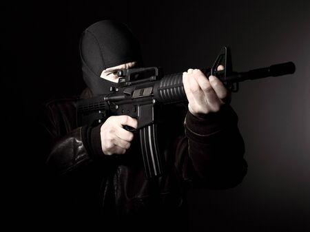 hijacker: portrait of criminal with m4 rifle