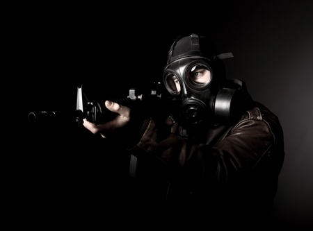 hijacker: portrait of criminal with m4 rifle and gas mask Stock Photo