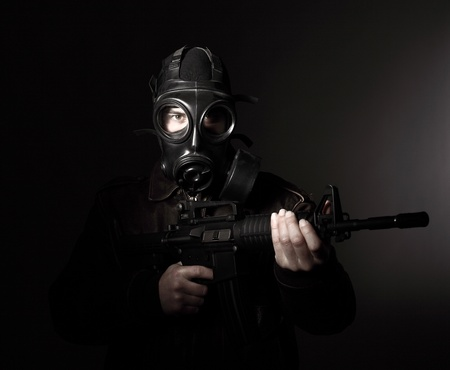 portrait of criminal with m4 rifle and gas mask Stock Photo