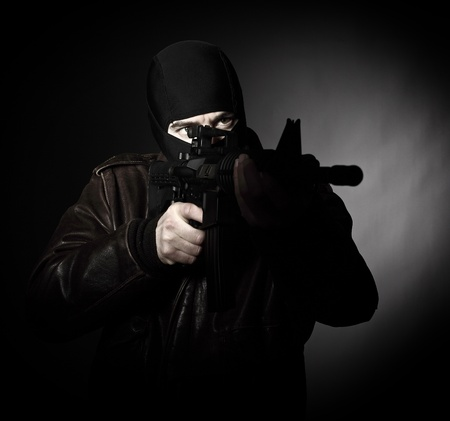 portrait of criminal with m4 rifle photo