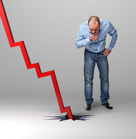 man look down and red falling chart photo