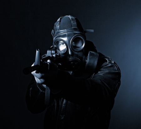 terrorist with gasmask dark background photo