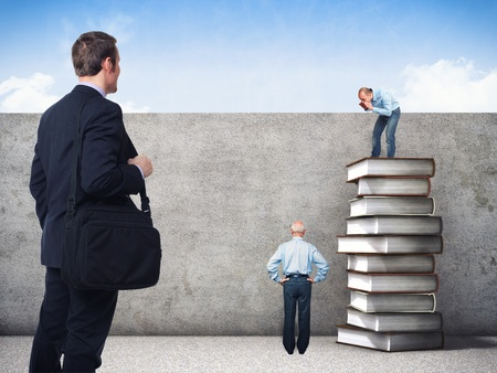 man looking at sky: people and 3d image of book pile and grunge wall Stock Photo