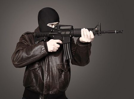 portrait of terrorist with automatic rifle photo