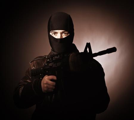 hijacker: portrait of terrorist with automatic rifle